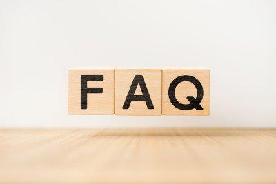 wooden scrabble letters spelling FAQ