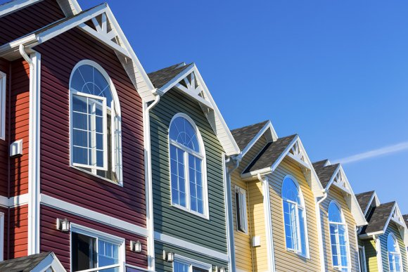 row of colorful townhomes