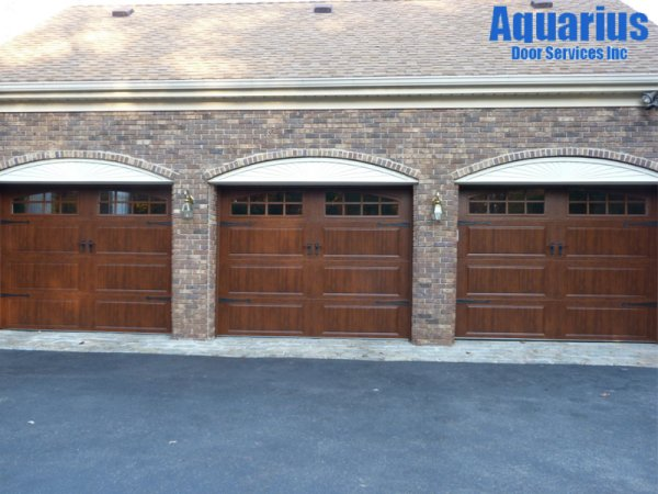 three brown garage doors in Wyckoff